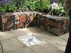 Gabion garden edging filled with old clay garden pieces, recycled bricks, clay pots etc..