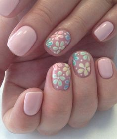 A gentle manicure with floral motifs created for girls who prefer quiet colors. Nude varnish will be appropriate in the office, and several interesting acc