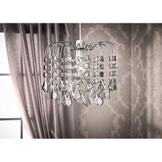 Louisa Chandelier - Smoke Grey. This glitz and glam looking Chandelier will create style in any room. Available in 2 designs.Also available: Clear - B&M.