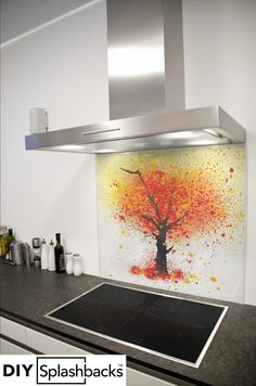 Abstract Tree printed glass splashback. All of our splashbacks are made from toughened safety glass, are available in any size, and come with a 7 year warranty. Visit diysplashbacks.co.uk to discover more.