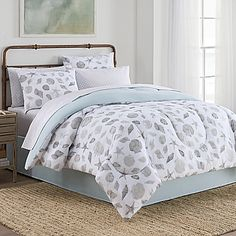 Bring a coastal vibe to your room with this beautiful Seashells Comforter Set. Featuring a soothing seashell print in tones of grey and aqua on a white ground, the comforter features a solid aqua reverse and is complemented by a grey lattice sheet set.