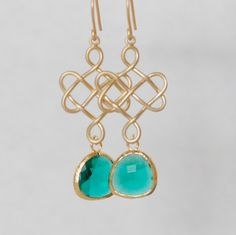 A personal favorite from my Etsy shop https://www.etsy.com/listing/262572362/gold-celtic-knot-w-emerald-green