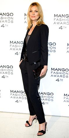 KATE MOSS  As the face of Spanish brand Mango, the supermodel struts her stuff in a strong-shoulder blazer, cigarette pants and sexy sandals for the brand's Fashion Awards in Barcelona.