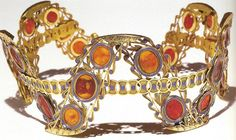 Cameo Diadem of Empress Josephine:  The cameos in this diadem are made from coral, each piece of which has color variations. It is set in gold with lapis-lazuli inlay.