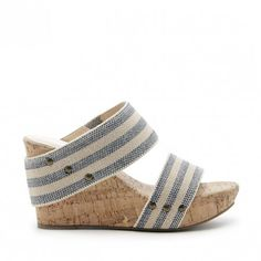 Platform slide on wedges crafted from lightweight cork with fabric straps, studded details and SO comfortable.