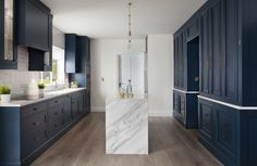 Hague blue kitchen, dark shaker cabinets, great modern country style