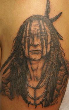 Native American w/painted face tattoo  Has to be one of the best tattoos I have laid my eyes on!!!