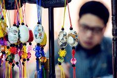 Art teacher creates unique paintings on silkworm cocoons