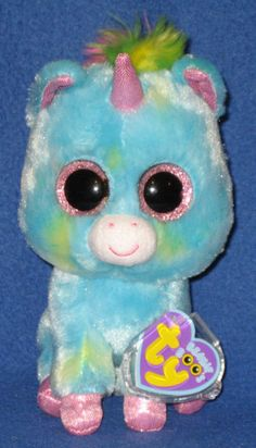 Pictured is an authentic TY Treasure the Unicorn. Treasure the Unicorn - TY  Beanie Boos. Treasure Boo is in mint condition except for the eyes which  are ... f86f7a9a07c7
