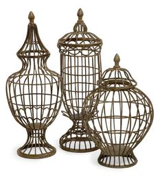 "Metal Lidded Urn Trio - Set of three metal lidded urns with finials in graduating sizes. Material: Wrought iron 100%. 14.25-19.25-19.75""h x 9.25-7.75-6.25""d."