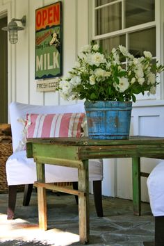the Polished Pebble porch with cottage style furnishings Country Decor, Farmhouse Decor, Farmhouse Style, Cottage Porch, Cottage Style, Cozy Cottage, Outdoor Spaces, Outdoor Living, Outdoor Decor