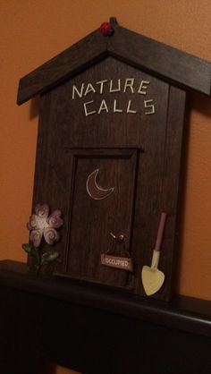 Outhouse DIY.  This is what you can do with odds and ends left over from laminate flooring.