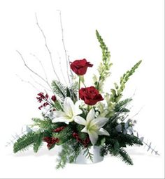 Just as fresh-fallen snow glistens in the sunlight, so does this silvery bowl – bearing its load of glittery branches, shiny red berries and a holiday mix of red roses and white lilies. Our glittering floral arrangement is a joyous gift for a friend, or a fun centerpiece for a holiday gathering. Hand made by the best local Teleflora florist.   - $54.97 Available online for worldwide delivery at Brant Florist.