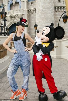 It's Mickey Mouse! Stefani also got in a posing session with none other than Mickey Mouse,...