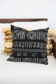 $79.00 These beautiful cushions are made with traditional Malian 'Bogolanfini' or mudcloth. The cloth is woven by hand in small strips and then lovingly sewn together before being dyed and printed using the rich colours of African mud. Encapturing the elements, these unique cushions bring subtle texture and a special story into your home. Finished with a raw silk back and invisible zip. ** This is for the cushion cover only. If you would like an insert as well we have a lovely humane duck…
