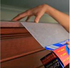 place a layer of wax paper on the top of kitchen cabinets where dust and grease collects. Every few months changed out the paper...you can also do this on top of the fridge