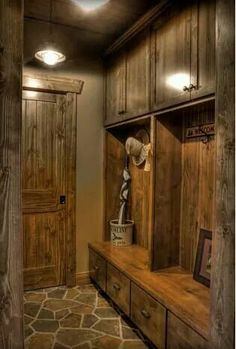 Wow! What a  mudroom, like the wood and western feel