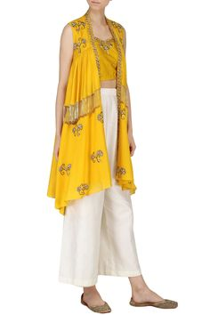 KAZMI INDIA Turmeric Yellow Embroidered Bustier with Cape and Palazzo Pants Set. Shop now! #kazmiindia #turmericyellow #yellow #embroidered #bustier #cape #palazzo #ethnic #fashion #indianfashion #indiandesigners #perniaspopupshop #happyshopping