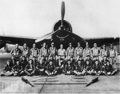 """Portrait of legendary Lost Squadron in front of #28, the lead plane of """"Flight   19"""" that supposedly vanished into the Bermuda Triangle shortly after WWII.    Flight 19 was the designation of five TBM Avenger torpedo bombers that disappeared   on Wednesday, December 5, 1945 during a Navy-authorized navigation training flight from Naval Air Station Fort Lauderdale, Florida. All 14 airmen on the flight were lost."""
