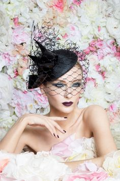 Beautiful black millinery works great with this mercury grey. This gorgeous piece is by legend Philip Treacy London x