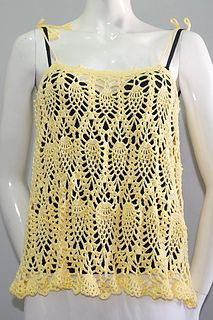This is a free crochet pattern for Marie Beach Top. It has photo tutorial in each step to guide you.