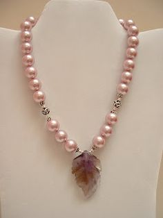 These are really gorgeous high quality South Sea Shell Pearls in a beautiful satin pink, I added a hand carved amethyst leaf and Bali silver beads, I love these pearls they have a nice weight and look stunning!  I have just a few strands left in various colors. (a previous pinner)