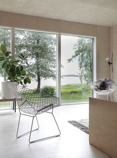 A beautifully simple cabin on an island in Finland - love the windows