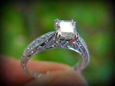 Side view of a Kirk Kara antique styled engagement ring in white gold. You can find this at Diana Jewelers in Liverpool, NY. Right outside of Syracuse!