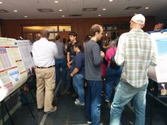 Pre-service and in-service BERET 2014 teacher pairs present their research at the annual poster session.