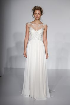 Illusion neck wedding dress with embellished bodice and soft skirt by @maggiesottero | Bridal Market Fall 2016