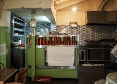 Στο ιστορικό οινομαγειρείο των Αμπελοκήπων οι τιμές και η ατμόσφαιρα έχουν μείνει σε περασμένες δεκαετίες και ανάμεσα στα βαρέλια με το κρασί αντηχούν οι φωνές από το γήπεδο του Παναθηναϊκού. French Door Refrigerator, Athens, French Doors, Kitchen Appliances, Home, Diy Kitchen Appliances, Home Appliances, Ad Home, Homes