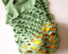 T-Shirt Grocery Bag    (images via: ecouterre)  Making your own reusable shopping bags has never been easier than this. Old t-shirts with moth holes, stains or unwanted designs make stretchy, colorful totes with minimal sewing. Check out the tutorial at Ecouterre.
