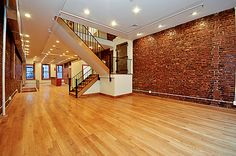 Have always loved the look of a loft! White walls, wood floors, exposed brick!