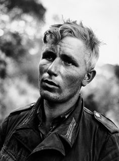 Robert Capa - A German soldier after he had been captured by American troops near Nicosia in July 1943