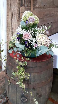 Wedding flowers on a barrel.  Amnesia roses and hydrangea.