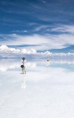 """""""Salar de Uyuni, Bolivia""""  The World's largest salt flat, located about 12,000ft above sea level. During the rainy season, it turns into the world's largest mirror, the reflection of the clouds and the sky on the water creates a sense of infinity. Tourists are only able to travel to this location via hot air balloon.  It is known as the border between Heaven and Earth"""