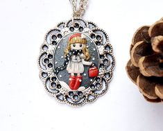 Girl pendant 'It's cold outside...'  at https://www.etsy.com/listing/211492396/cute-girl-christmas-theme-gift-vintage