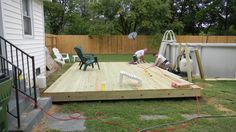 ground level small rectangular deck  | Ground level deck and pump house for above ground pool