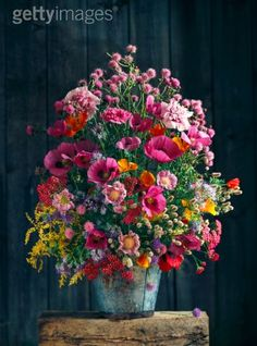 Mixed Bouquet of Poppies and Cottage Garden Flowers in Metal Vase