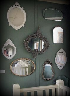 Nice collection of mirrors on stairs wall