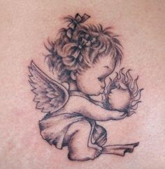 Little Angel Tattoo I would want this small and kissing a butterfly or bunny!!!!