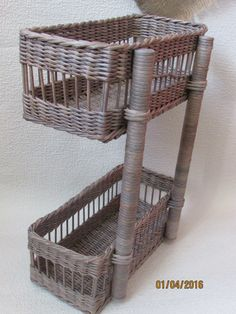 tie with string the baskets to the branches and then hang on the wall - nice workwood idea