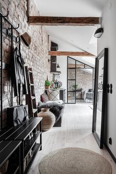 An Industrial Look For A Small Attic Apartment in Stockholm — THE NORDROOM - - New York vibes in a small Scandinavian attic apartment with exposed brick walls and industrial elements. Design Apartment, Attic Apartment, Dream Apartment, Apartment Living, Industrial Apartment, Industrial Interior Design, Industrial House, Home Interior Design, Industrial Style