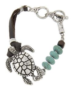We will have more available this week.  Turtle stretch bracelet with turquoise colored beads and toggle closure.