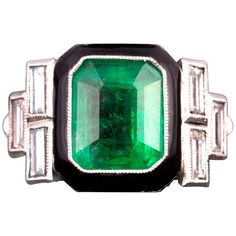 Art Deco Colombian Emerald Diamond Platinum Ring | From a unique collection of vintage cocktail rings at https://www.1stdibs.com/jewelry/rings/cocktail-rings/