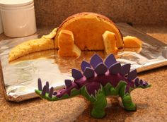 Dinosaur Cut Up Cakes | next i used my son's dinosaur toy as a model and began carving the ...