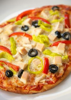 Mediterranean Chicken Flatbread - chicken, red pepper, olives, pepperoncini peppers topped with Sargento Shredded 6 Cheese Italian blend. SO good and easy!