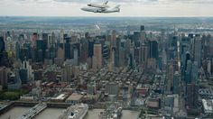 Space shuttle Enterprise flies over New York City