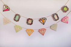 Make a gemstone garland to add interest to a boring white wall.   35 Completely F*cking Awesome DIY Projects