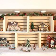Above cabinet decor for Christmastime? Create your own Christmas village display case or compose your own holiday story by using wooden crates as the backdrops for individual scenes. Christmas Village Display, Christmas Town, Christmas Villages, Christmas Traditions, Christmas Holidays, Christmas Crafts, Christmas Mantles, Victorian Christmas, Pink Christmas
